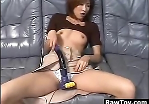 Japanese MILF Masturbating With A Machine